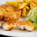 Served plate with Fried Chicken Meat and French Fries
