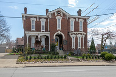 Johns House — Lexington, Kentucky (Pythaglio) Tags: johns house lexington kentucky unitedstatesofamerica us dwelling residence historic fayettecounty twostory brick italianate chimneys cornice brackets hoodmolds segmentalarched porch bushes hedges clouds incised carvings