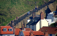 Down the long steps at Whitby (Tony Worrall) Tags: yorkshire yorks scene scenery northyorkshire resort yorkshirephotos east eastern seasidetown holidays tourists coast photographsofwhitby whitbyphotos whitby north update place location uk england visit area attraction open stream tour country item greatbritain britain english british gb capture buy stock sell sale outside outdoors caught photo shoot shot picture captured ilobsterit instragram climb steps stairs long zoom candid people