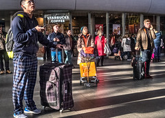 Time to stand and stare (Marion McM) Tags: streetphotography station waiting shadows sunlight people luggage kingscrossstation london england 2018 railwaystation canonpowershotg7xmarkii tonemapped