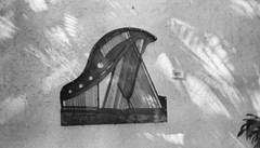piano art (.grux.) Tags: canonelphjr aps film polaroid200 expiredfilm wallart piano strings soundboard art shadows hanging ixtapa mexico