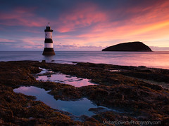 Sunrise at Pen Mon (Michael Sowerby Photography) Tags: sunrise coast sea landscapephotography coastalphotography lighthouse anglesea northwales water rocks light colour sky clouds atmosphere morning dramatic canon 5dsr wales colourfulsky
