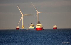 Turbines and ships (mootzie) Tags: ships red blue turbines white sea waves aberdeen scotland supply offshore