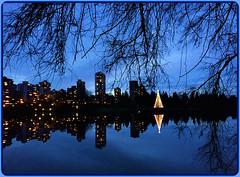Happy New Year Wishes! (FernShade) Tags: vancouverbc stanleypark lostlagoon lostlagoonchristmastree water lake lagoon reflections scenery scenic sky dusk twilight lights reflectedlights park