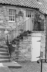 Mangle Cottage (stevebeck66) Tags: ilford film analog mangle cottage pittenweem fife scotland olympus om1 hp5 plus stone steps railing oldfashioned village quaint antique pantiles pantile roof wall door window lintol lintel setts mono bw staircase stair yesteryear 35mm