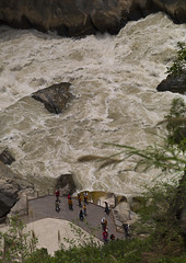 Tiger Leaping Gorge And Jinsha River, Lijiang, Yunnan Province, China (Eric Lafforgue) Tags: a0007893 asia china colorpicture day deep flowing forest groupofpeople highangleview jinshariver lijiang mountain nature outdoor powerinnature ravine realpeople tigerleapinggorge vertical yangtzeriver yunnan yunnanprovince