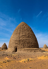 Beehive tombs, Nubia, Old Dongola, Sudan (Eric Lafforgue) Tags: africa ancient architecture beehive buildingexterior builtstructure cemetery colorimage copyspace day death desert dongola dry funerarymonument grave islam mudbrick nawamis nopeople northsudan northernsudan nubia olddongola outdoors photography qubba qubbas religion saharadesert sand scenics spirituality sudan sudan180470 sunny thepast tomb tranquilscene traveldestinations vertical