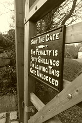 Sign on gate by Bridge 23, Hagg Bank Lane  (Peak Forest Canal)   February 2019. (dave_attrill) Tags: sign gate penalty warning fortyshillings bridge disley strines peakforest canal towpath peakdistrict nationalpark derbyshire cheshire february 2019 sepia cheshirering
