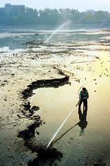 Clearing out the Qianhai (paulchapmanphotos) Tags: minolta xg1 kodak gold film is dead beijing lake qianhai china 1998 cleaning hose