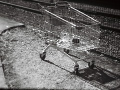 Abandoned shopping trolley (photo 2) (Matthew Paul Argall) Tags: hanimex108f fixedfocus 110 110film subminiaturefilm lomographyfilm blackandwhite blackandwhitefilm 100isofilm shoppingtrolley shoppingcart