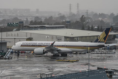 singapore airlines flight sq 1 to hong kong holding for gate assignment (pbo31) Tags: bayarea california nikon d810 color february 2019 boury pbo31 rain fog wet weather winter reflection sanfranciscointernational sfo airport plane airline aviation sanmateocounty terminal over singapore a350 airbus hongkong sanbruno gray travel