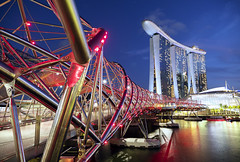 Singapore Nights (parkerbernd) Tags: singapore night lights blue hour helix bridge spectacular marina bay hotel water reflection travel skyline tourist attraction illuminated lumix gx9 long exposure le explore architecture design skyscraper building