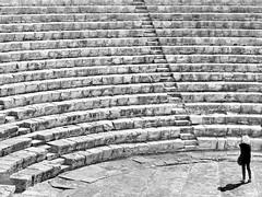 Greek-Roman Theatre (heinzkren) Tags: blackandwhite monochrome panasonic lumix cy urban theater cyprus cypern lines treppe stiege woman seats stairs steps stairway street streetphotography stufen shadow archeologie stone stonesteps empty archäologie archeology limassol architektur architecture kourion arena old human building center