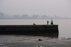 On a pier (theq629) Tags: taiwan xinbei tamsui person pier water