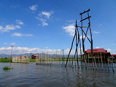 Lake living (Claire Backhouse) Tags: lake living water lakeside floatinghouse myanmar burma burmese powerlines electricity fence gate bluesky landscape mountains beautiful quiet domestic