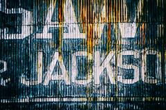 Saw & Jackson? (Explored) (Katrina Wright) Tags: dsc3196edit granvilleisland corrugated metal rust paint weathered worn sign lettering painted sliderssunday