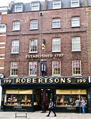 Suttons & Robertsons, London, UK (Robby Virus) Tags: london england uk unitedkingdom greatbritain britain gb english british suttons robertspns pawn shop store pawnbroker sign signage neon clock