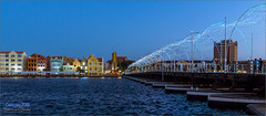 Willemstad - Curaçao (Hans van Bockel) Tags: curaçao d7200 hansvanbockel lightroom mensen nikon vakantie willemstad cw 1680mm emmabrug pontjesbrug handelskade annabaai bluehour blauweuur dusk schemer avond