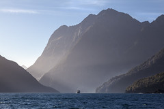 Milford Sound (Joost10000) Tags: milford sound milfordsound fiordland southisland newzealand pacific tasmansea tasman sea fiord fjord ocean water mountain mountains boat ship waves light outdoors natur nature canon canon5d eos wild wilderness travel backlight