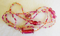 Lovely glass bead Mardi Gras necklace (Monceau) Tags: mardigras glass bead necklace pink clear macro 64365 pictures 365picturesin2019 365the2019edition 3652019 day64365 05mar19