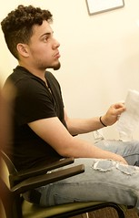 Young guy waiting (LarryJay99 ) Tags: man men guy guys dude male studly manly dudes handsome people virile jeans tornjeans stubble facialhair musculararms seated iphone7