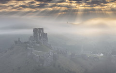 Corfe Castle In The Mist, Dorset (MelvinNicholsonPhotography) Tags: corfecastle dorset mist sunrise dawn crepuscularrays sunrays