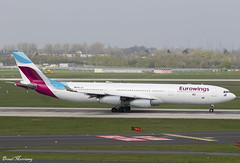 Eurowings A340-300 OO-SCX (birrlad) Tags: dusseldorf dus international airport germany aircraft aviation airplane airplanes airline airliner airlines airways eurowings airbus a340 a343 a340300 a340313 taxi taxiway takeoff departing departure runway ooscx ew1104 fortmyers