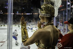 Hockey and the Showgirl (explored #12) (evanffitzer) Tags: showgirls fujix100s fujifilmx100s vegas lasvegas hockey nhl ice fans glass feathers evanffitzer evanfitzer photography photographer lightroom entertainment indoors
