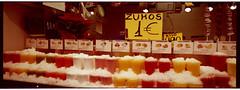 barcelona_xpan_zumos (faustosiopasinatiss) Tags: xpan xpa2 hasselblad fuji fujifilm barcelona bcn analog analogphotography film ishootfilm pan panoramic camera 45mm spain cataluna market boquesria zumo zumos fruit juice succo