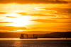 Sunset Minus 12 (ianrwmccracken) Tags: inchmickery d750 nikon sunset ship scotland bright golden sigma150600mm island riverforth boat lothian sunlight contrejour silhouette perspective telephoto windturbine aerialperspective contour