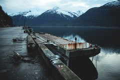 (i threw a guitar at him.) Tags: alaska skagway march 2019 early spring pier dock harbor harbour boats barge boat water mountain mountains local economy industry shipping pavement concrete southeast south east blue evening cloudy landscape