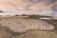 Bosa_Sabba_Druche_180013 (ivan.sgualdini) Tags: 1635mm italy seaitaliano alone beach canon cloudy italia rock sardegna sardinia sea seascape storm watermoon