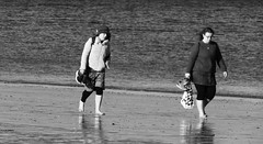 Seaside Strolling 05 (byronv2) Tags: edinburgh edimbourg scotland sea seaside coast coastal peoplewatching candid street walking water river rnbforth firthofforth riverforth forth portobello blackandwhite blackwhite bw monochrome woman paddling barefoot feet wading