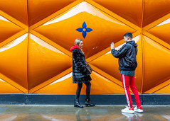 """Say """"Red Leicester"""" (DobingDesign) Tags: streetphotography orange color colourpop colourblock quiltdesign 3dhoarding diagonals isometric pattern photographer smile saycheese louisvuitton retail shopfront shop lines angles bright saturated havingfun smiles posing smartphoneusers laughing shiny"""