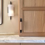 Beautiful oak cabinetry, unique leather hardware and sleek sconces turn this Mill Valley bathroom into a beautiful and modern remodel by @florencechouxlivingston. Featured: Leather and Wood Handle - The Sellwood thumbnail