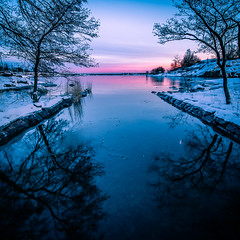 Uunisaari - Helsinki, Finland - Seascape photography (Giuseppe Milo (www.pixael.com)) Tags: photo landscape sunset finland reflection city helsinki clouds sun snow uunisaari trees sea travel pink photography island sky seascape nature europe geotagged snowing uusimaa fi onsale