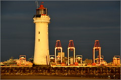 Fort Perch Rock Lighthouse and (Port of Liverpool) Liverpool Two  STS Container Cranes illuminated at sunset 2nd January 2019 (Cassini2008) Tags: fortperchrocklighthouse newbrighton wirral lighthouse