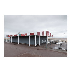 Beach Terrace (John Pettigrew) Tags: lines tamron d750 nikon shutters dull topographics red mundane ordinary documentary yarmouth johnpettigrew imanoot banal stripes closed spaces great deserted angles norfolk cafe documenting white