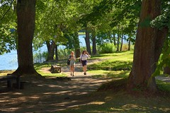 Lithuania /  Trakai /  Walking (Pantchoa) Tags: trakai lituanie europe forêt nature arbres herbe eau lac feuillages filles deux deuxfilles promenade verdure ombres île banc