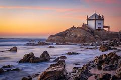 The Chapel in the sea (Artur Tomaz Photography) Tags: people yellow beach chapel orange portugal religious rocks sea senhordapedra sun sunset
