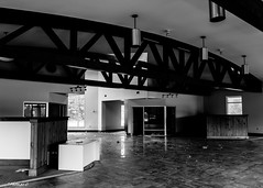 Abandoned Jaguar Dealership: Inside the Used Car Building (that_damn_duck) Tags: nikon blackwhite monochrome abandoned urbex urbanexplorer jaguardealership cardealership beams decay showroom bw blackandwhite