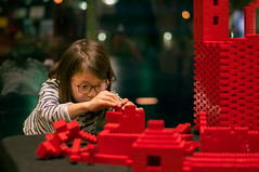 Build a new world (Kirmatic) Tags: red lego brick girl sony nex6 sel50f18 glasses night kid