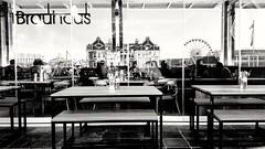 Brauhaus (Steven.Harrison) Tags: southafrica capetown reflection window people portrait bw bnw photography blackandwhite monochrome city adventure travel travelphotography table pub bar building harbour