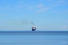 Blue and lonely (ucrainis) Tags: tallinn estonia sea baltic ship blue smoke water cloud clear sky summer sunny colourful travel transportation seascape