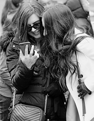 Liking their Selfie - Times Square, NYC (TravelsWithDan) Tags: youngwomen phone mobiledevice likingtheirselfie city urban nyc newyork manhattan timessquare candid streetphotography canong3x
