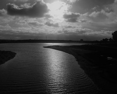 Gently Flowing (Rand Luv'n Life) Tags: odc our daily challenge harmony grace flow mission bay water ripples storm clouds sun glow monochrome blackandwhite outdoor san diego california peaceful