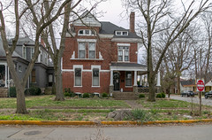 House — Lexington, Kentucky (Pythaglio) Tags: house dwelling residence lexington kentucky unitedstatesofamerica us historic twostory brick romanesque eclectic fayettecounty 11windows stringcourse chimneys porch rusticated stonework stone sidewalk street trees bushes