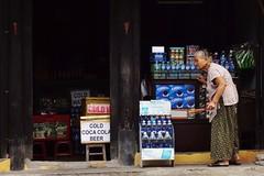 Hoi An - commerçante 4 (luco*) Tags: vietnam hoi an femme woman lady vieille old coca cola beer water bottles encens vietnamienne vietnamese