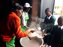 Students tasting millet porridge