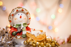 snowman close-up on the background of blurry colored lights tinsel and Happy New Year. (AlestrPhoto) Tags: new year background happy holiday card merry frame greeting white blue festive decoration view tree silver gift eve star invitation postcard wooden seasonal flatlay top bokeh bright winter red wood light glitter december snowman close up snow closeup space copy green toy concept decorative season decor ball pine fir